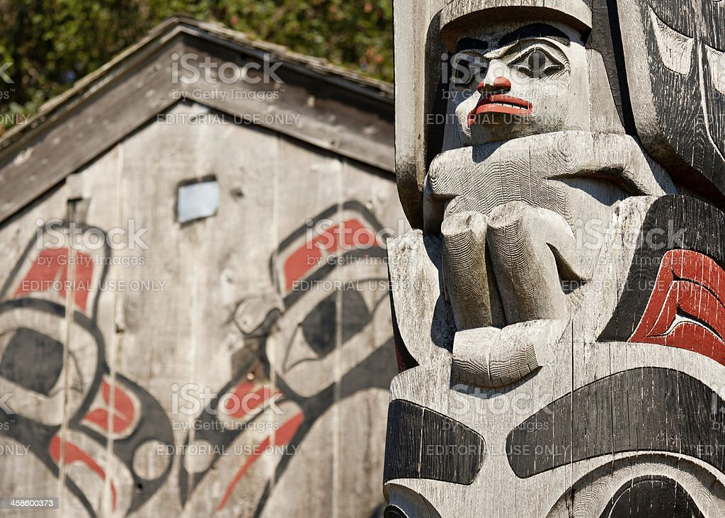 Haida Gwaii Totem Pole and Longhouse stock photo
