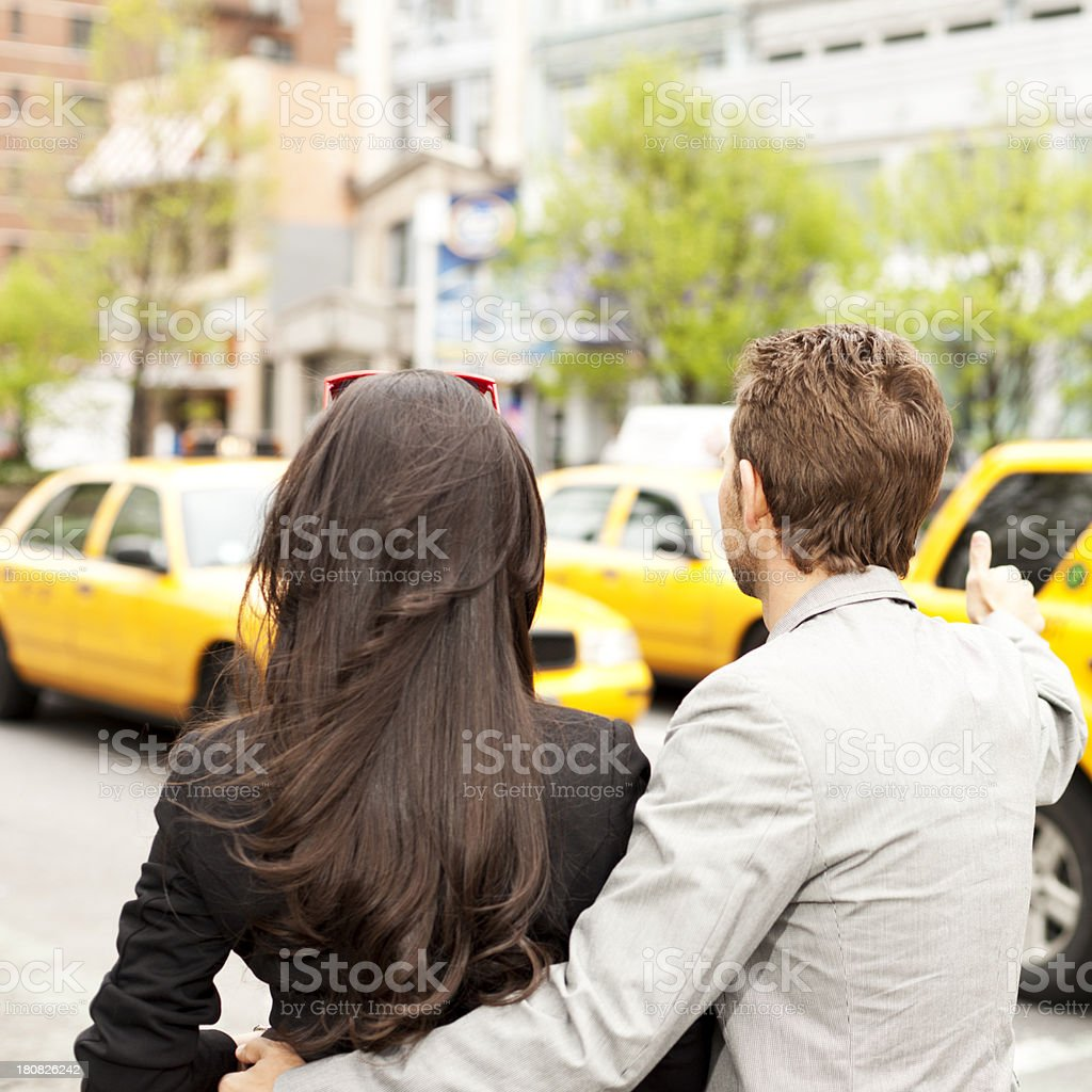 Hailing a yellow cab, New York City royalty-free stock photo