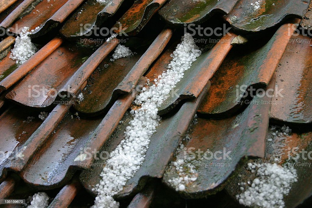 Hailstones on an old roof stock photo