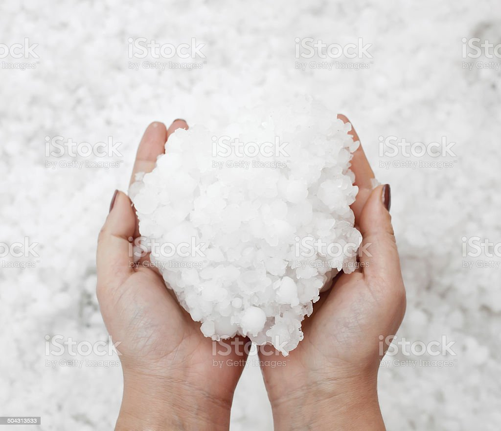 Hailstorm in the hands stock photo