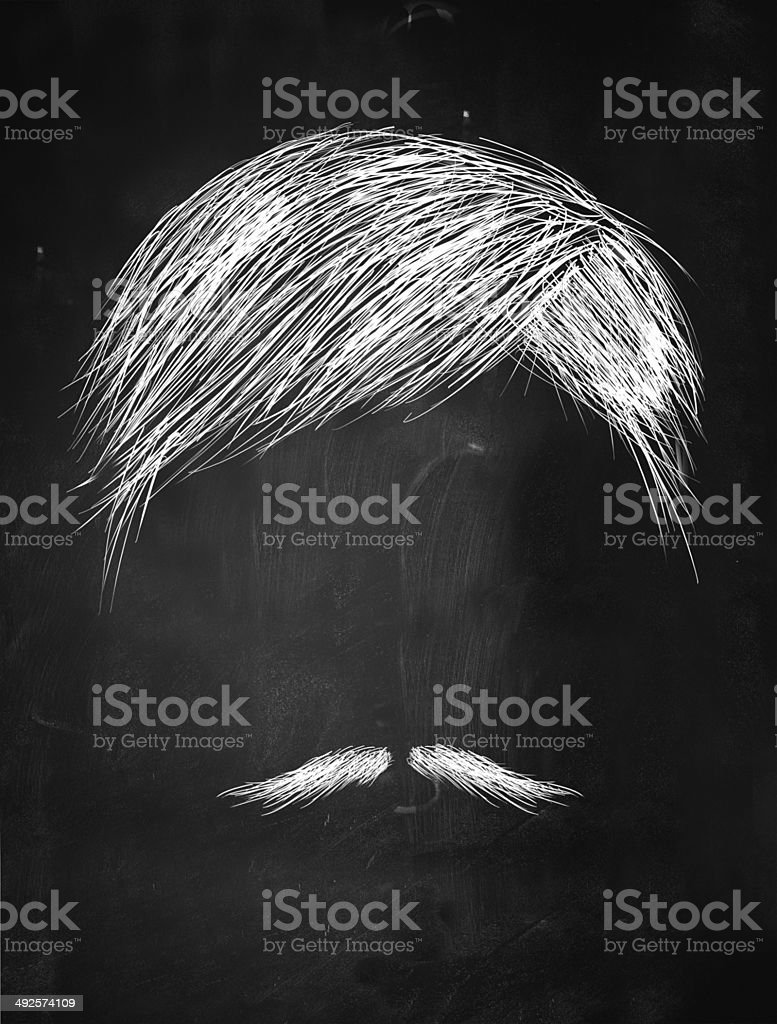 Hair and thin mustache sketch on blackboard stock photo