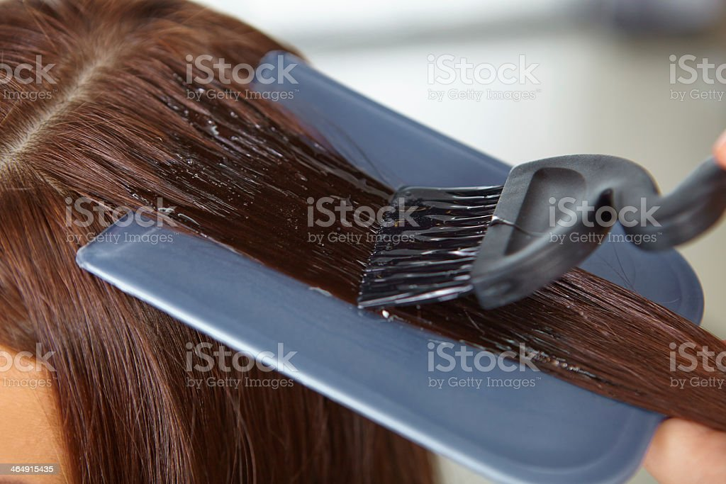 Hair color pigment application with dye liquid on brush stock photo