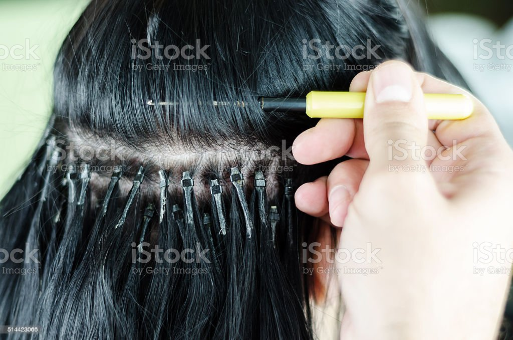 Hair extensions on a white background stock photo