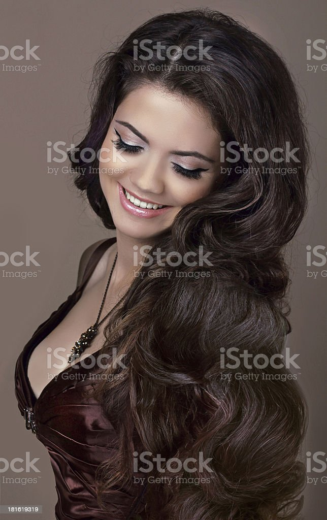 Hair. Fashion style. Happy Smiling Brunette Girl. Healthy Long royalty-free stock photo