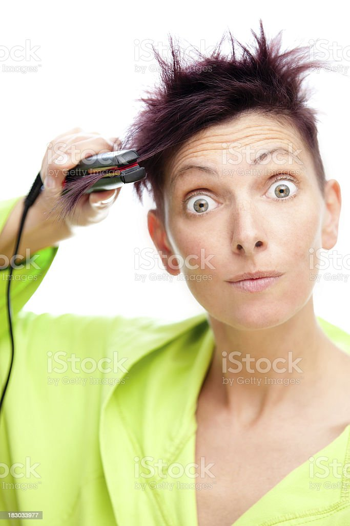 Hair ironing royalty-free stock photo