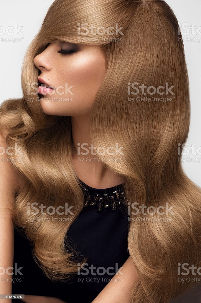 Hair. Portrait of beautiful Blonde with Long Wavy Hair. stock photo