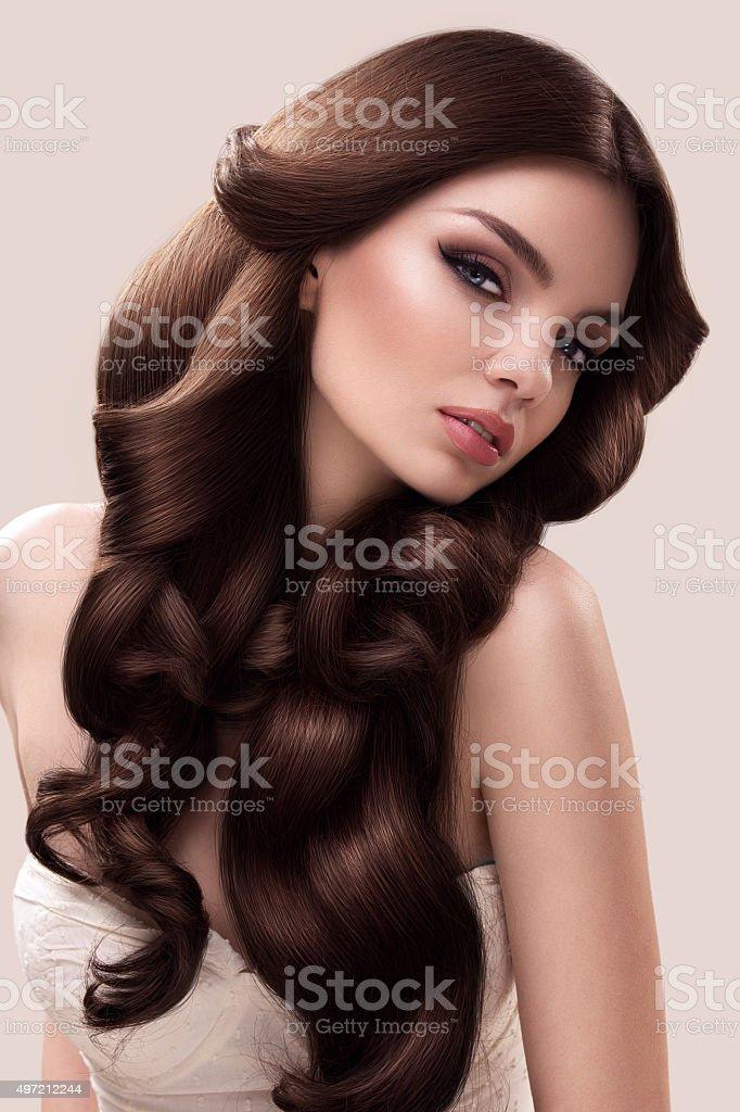 Hair. Portrait of Beautiful Woman's Long Wavy Hair. High quality stock photo