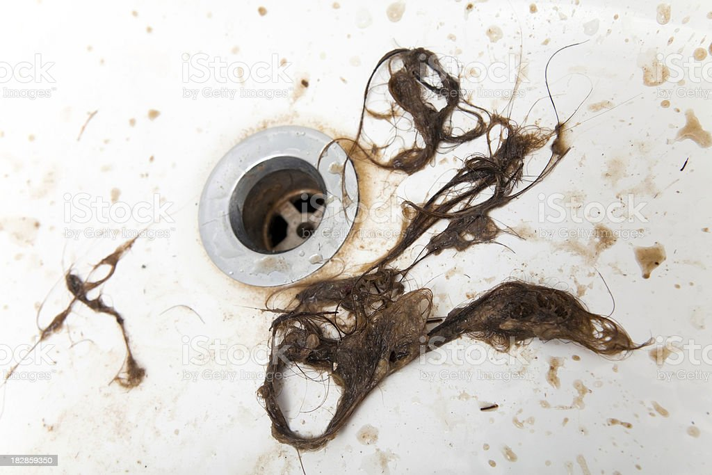Hair removed from a clogged drain stock photo