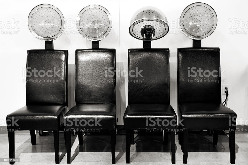 Hair Salon Blow Driers in a Row, Black and White royalty-free stock photo