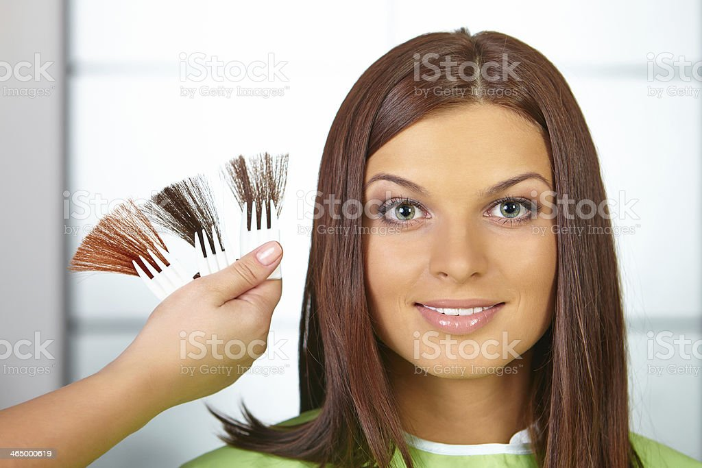 Hair salon. Woman choses color of dye. stock photo