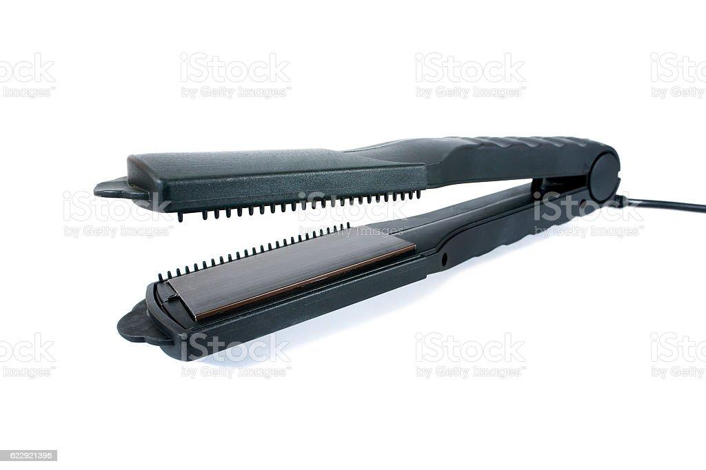 Hair straightener isolated on white background stock photo