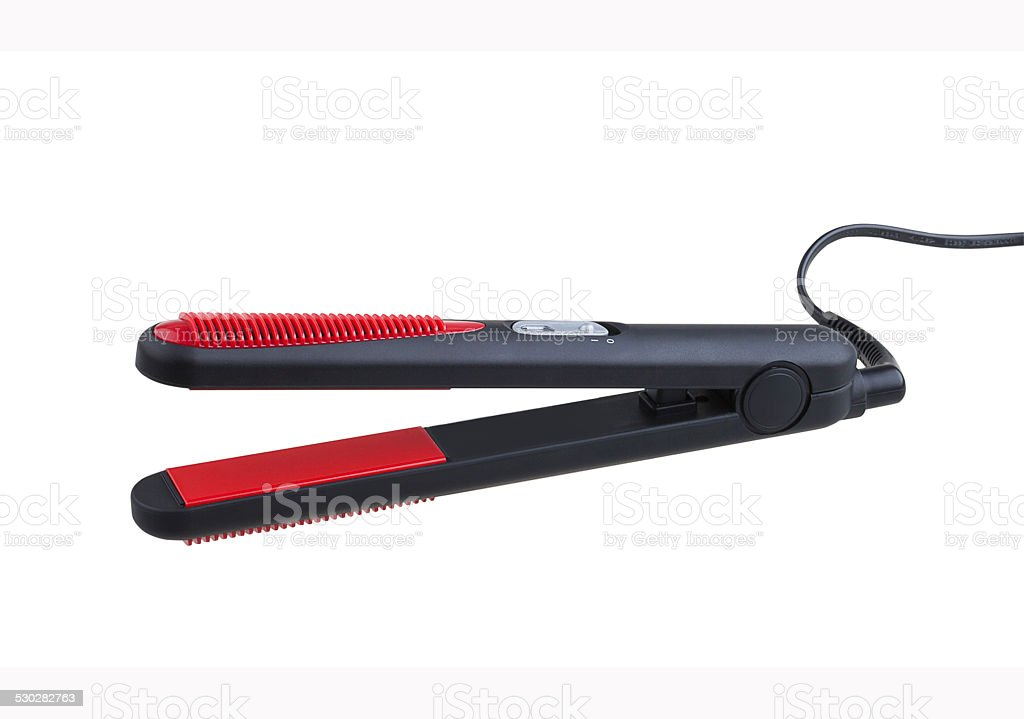 Hair straightener isolated on white stock photo