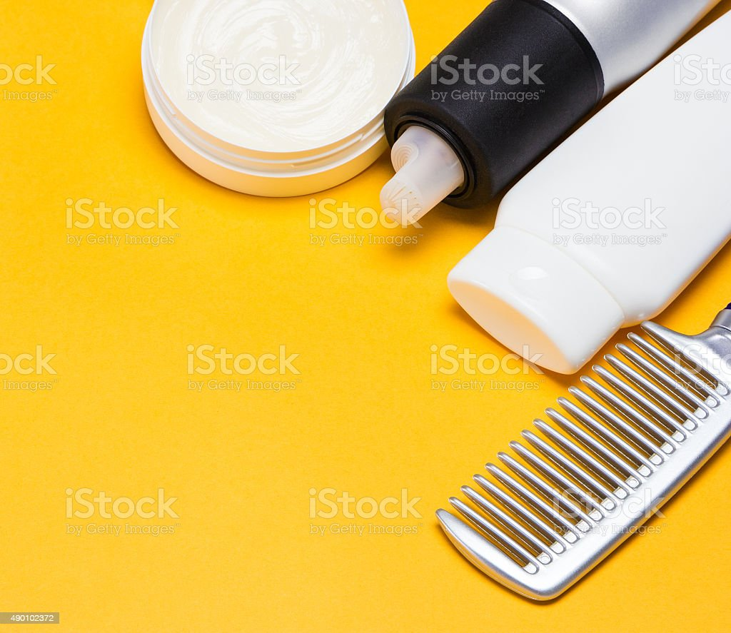 Hair styling products with a comb stock photo