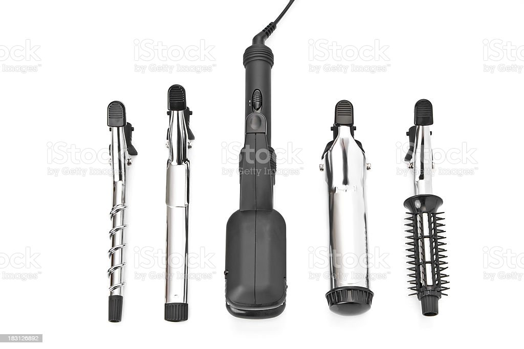 Hair styling set with straightener and curling accessories stock photo