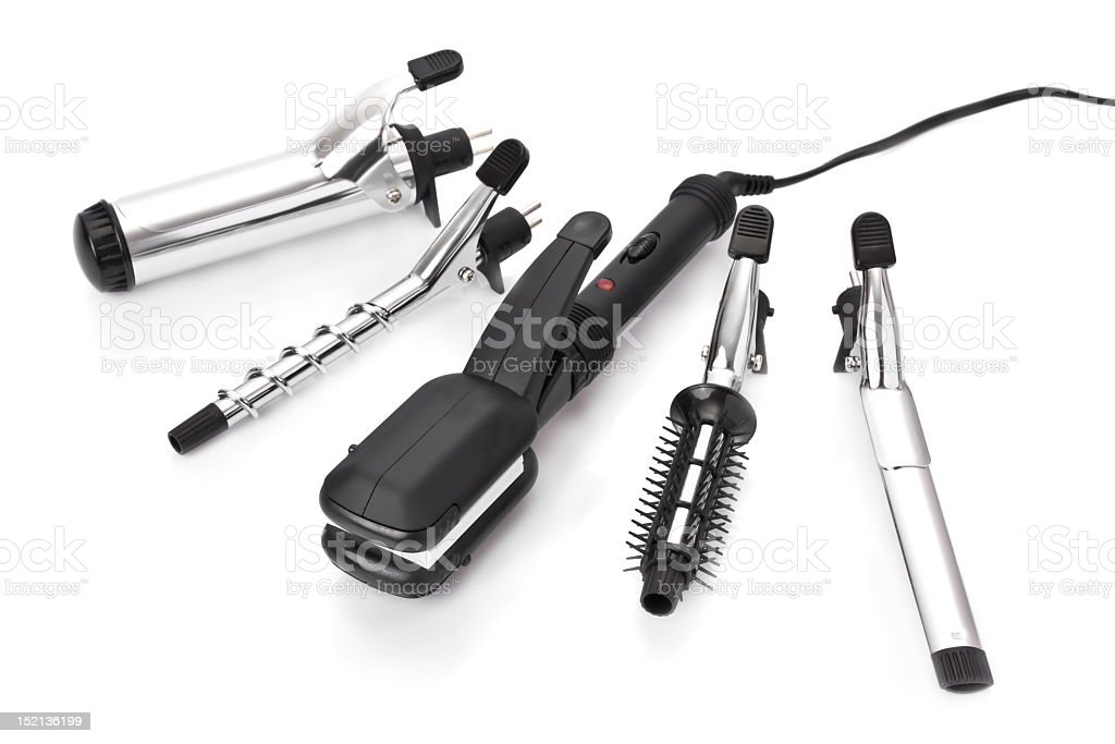 Hair styling set with straighteners & curling accessories stock photo