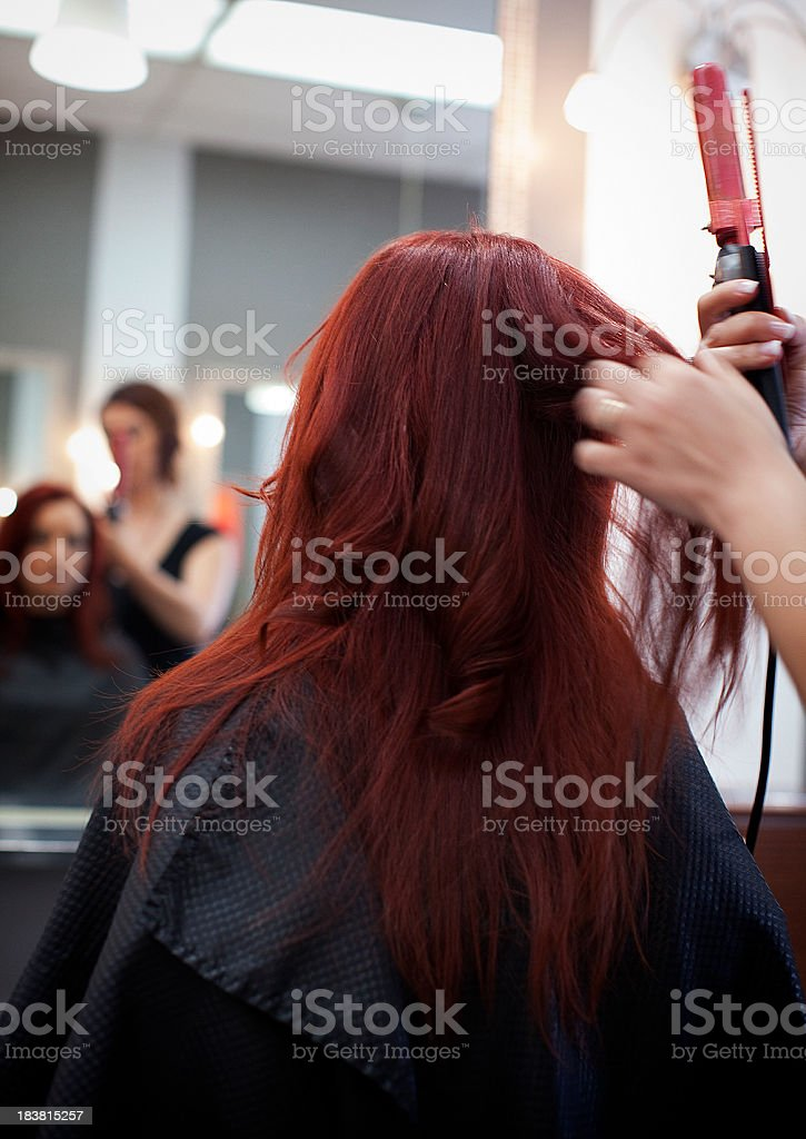 Hair stylist at work royalty-free stock photo
