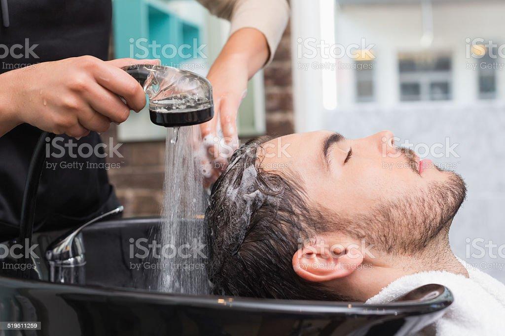 Hair stylist washing mans hair stock photo