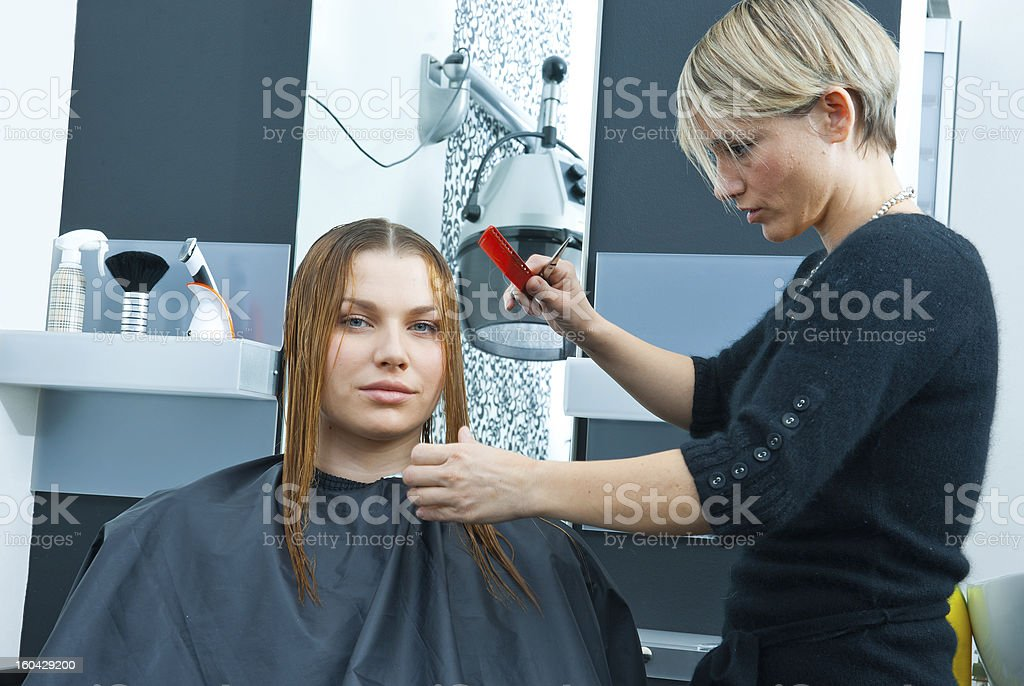 hair stylist working on woman haircut royalty-free stock photo