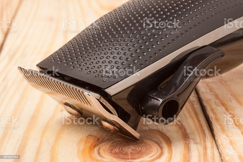 hair trimmer on a light wooden background closeup stock photo
