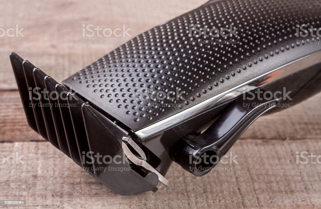 hair trimmer on an old wooden background closeup stock photo