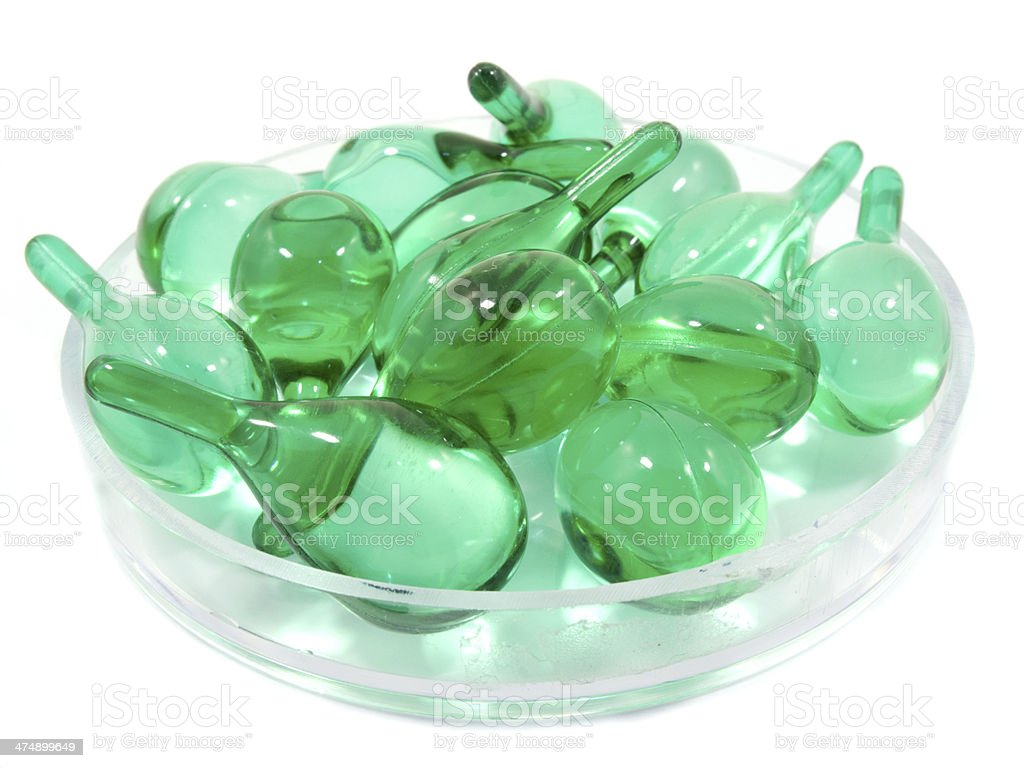 Hair vitamin serum capsule in container royalty-free stock photo