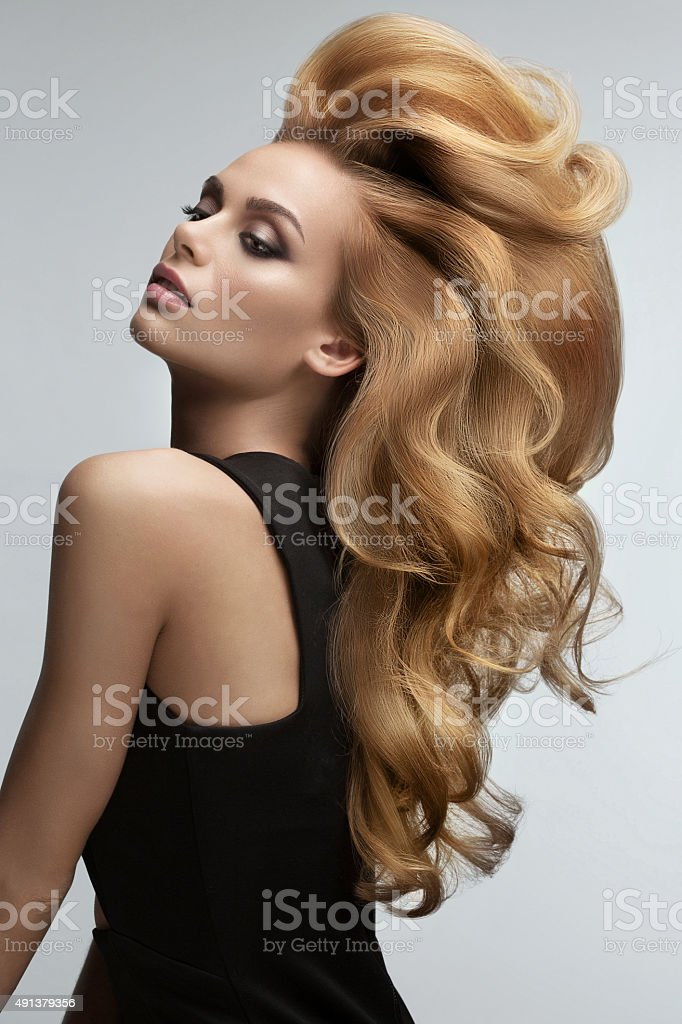 Hair volume.  Portrait of beautiful Blonde with Long Wavy Hair. stock photo