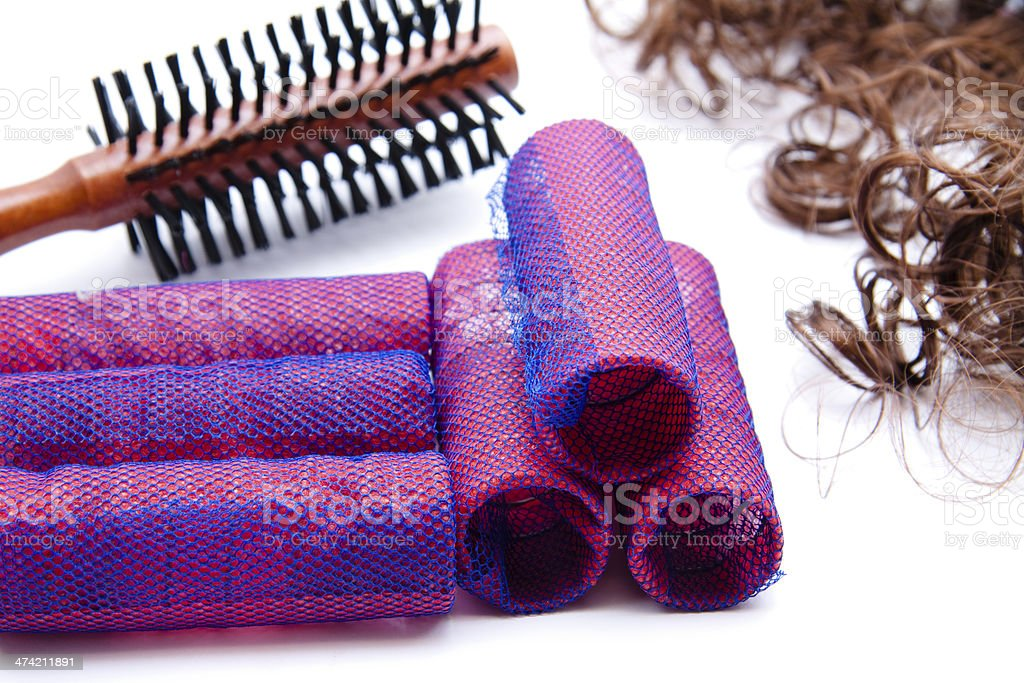 Hairbrushes and mauve curlers stock photo