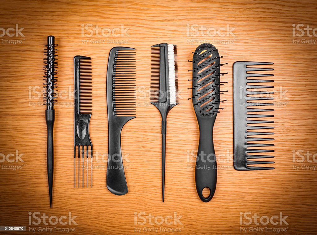 hairbrushes on a wooden background stock photo