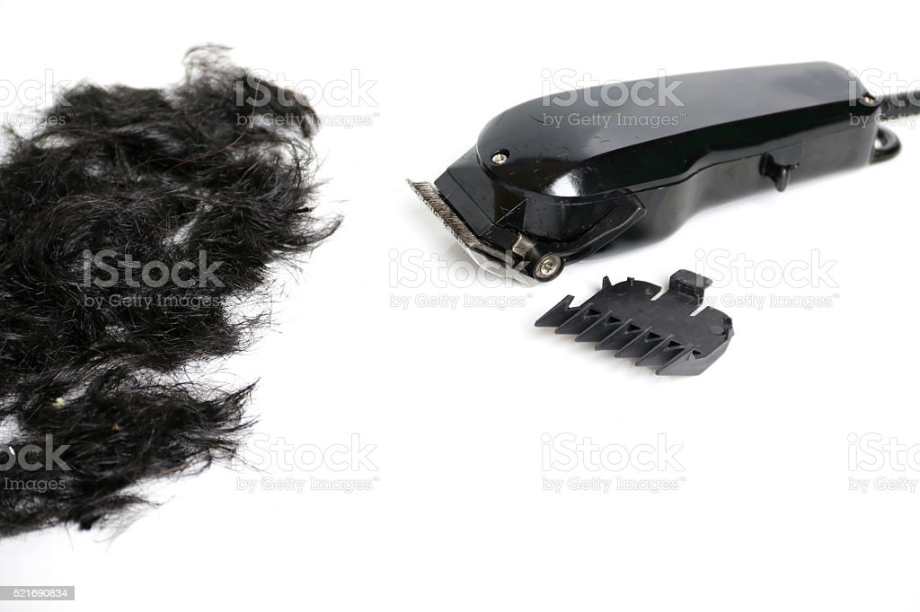 Hairclipper electricity with hairs on a white background. stock photo