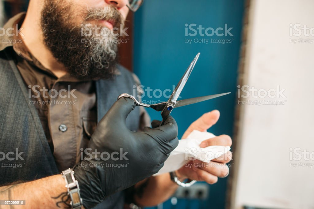 Haircut instruments desinfection after work stock photo
