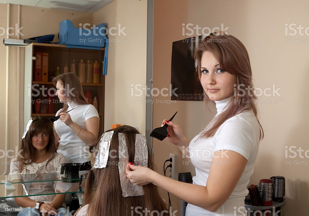 Hairdresser coloring    girl hair royalty-free stock photo