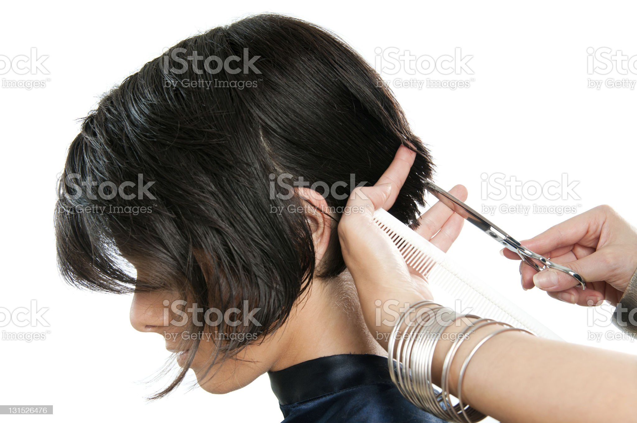 A hairdresser cutting the woman's hair royalty-free stock photo