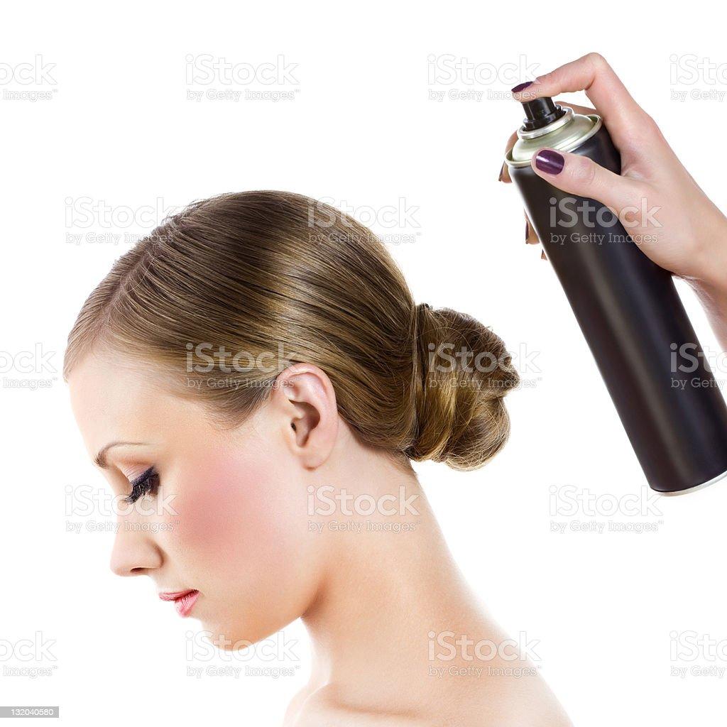 Hairdresser fixing woman hairdo stock photo