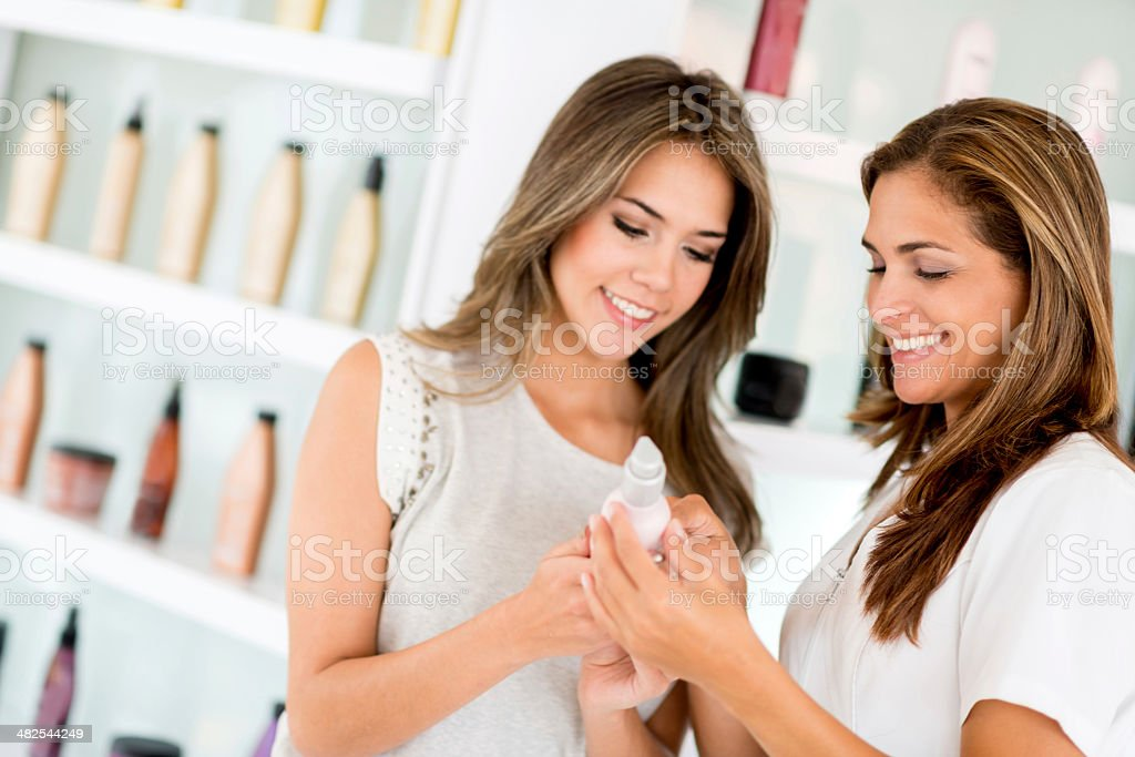Hairdresser selling beauty products stock photo
