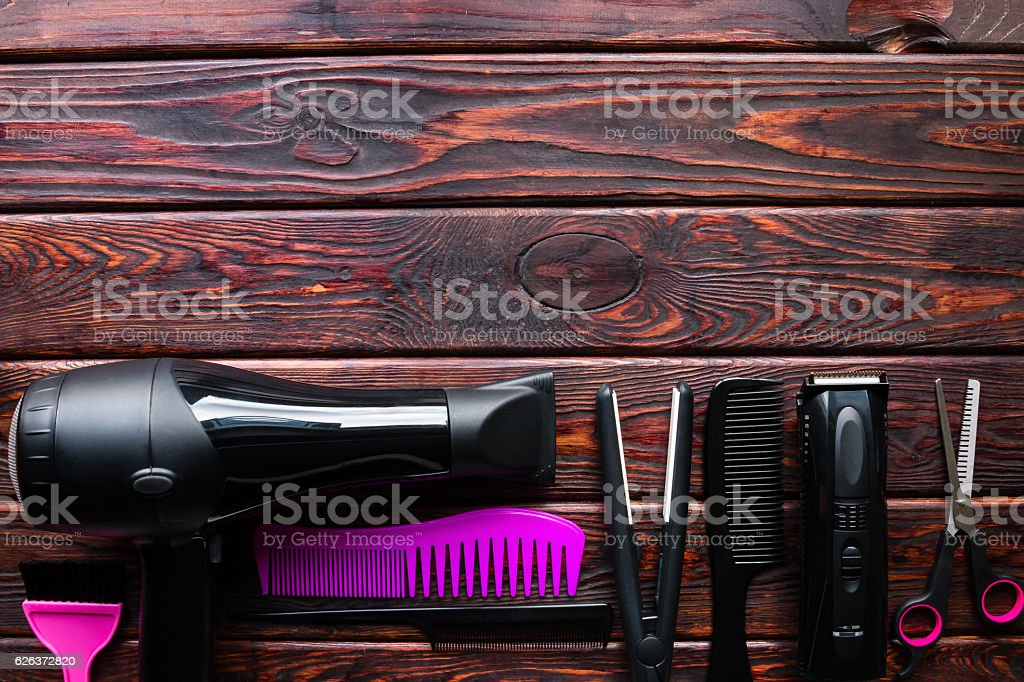 hairdresser set on a wooden background with space for text stock photo