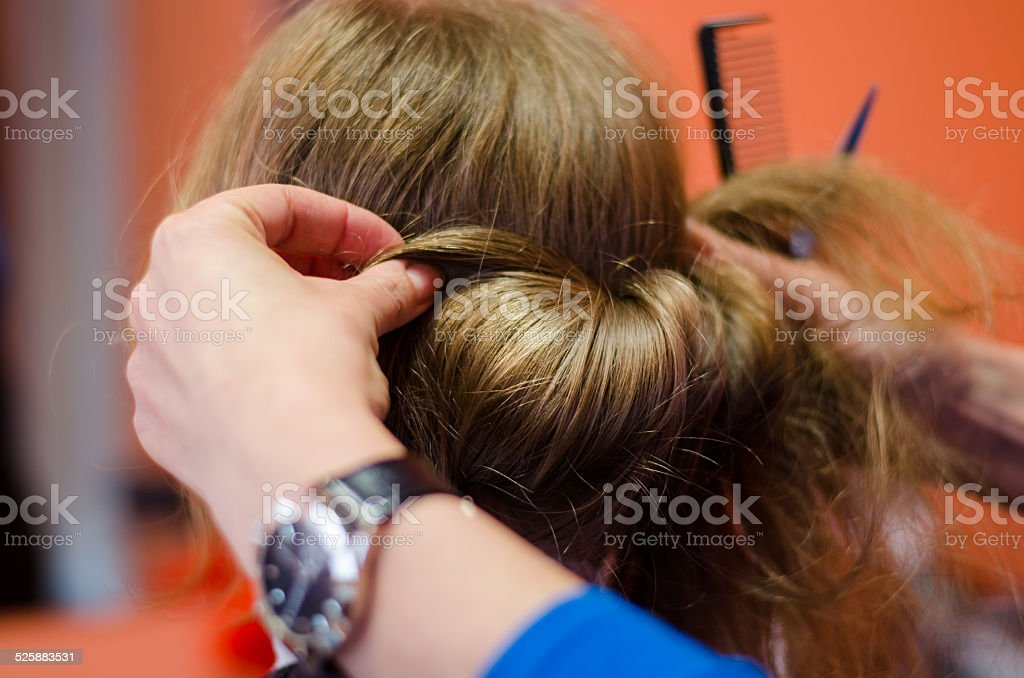 hairdresser shaped coiffure client of blond hair stock photo
