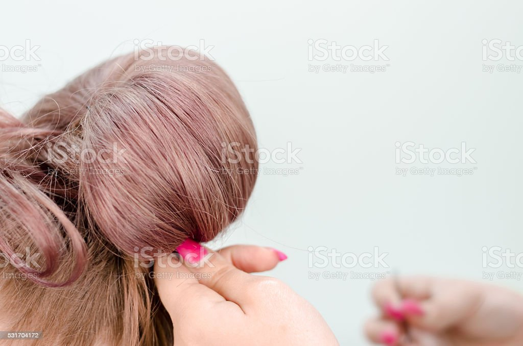 Hairdresser shaped hairstyle or raised red hair stock photo