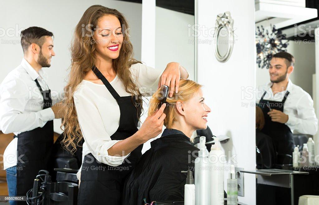 Hairdresser styling hair stock photo