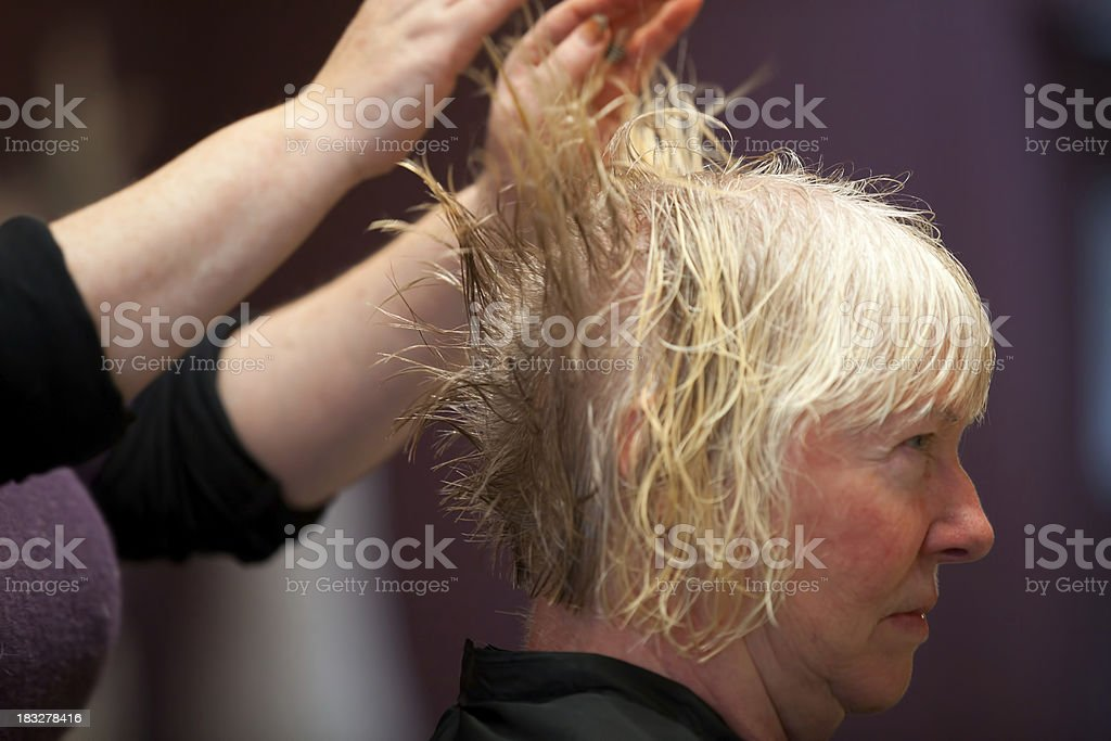 Hairdresser throwing hair up stock photo