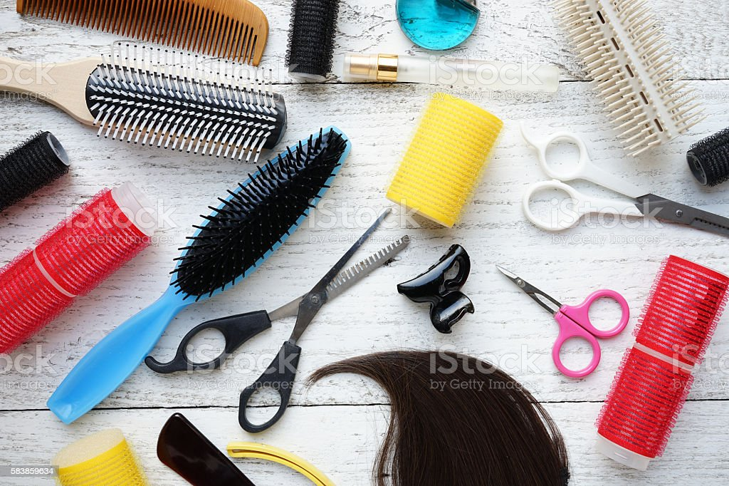 hairdresser tools on wood table stock photo