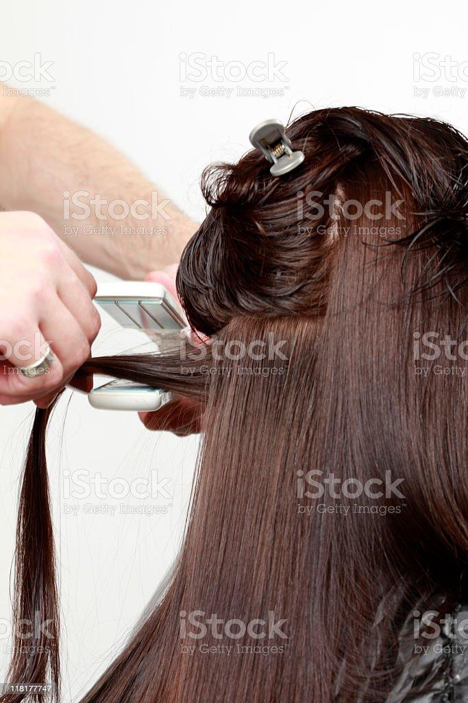 Hairdresser Using Flat Iron royalty-free stock photo