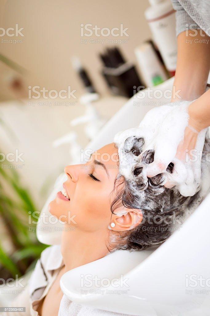 Hairdresser washing hair stock photo
