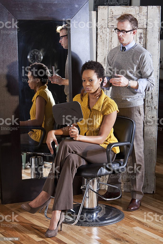 Hairdresser with client in beauty salon royalty-free stock photo