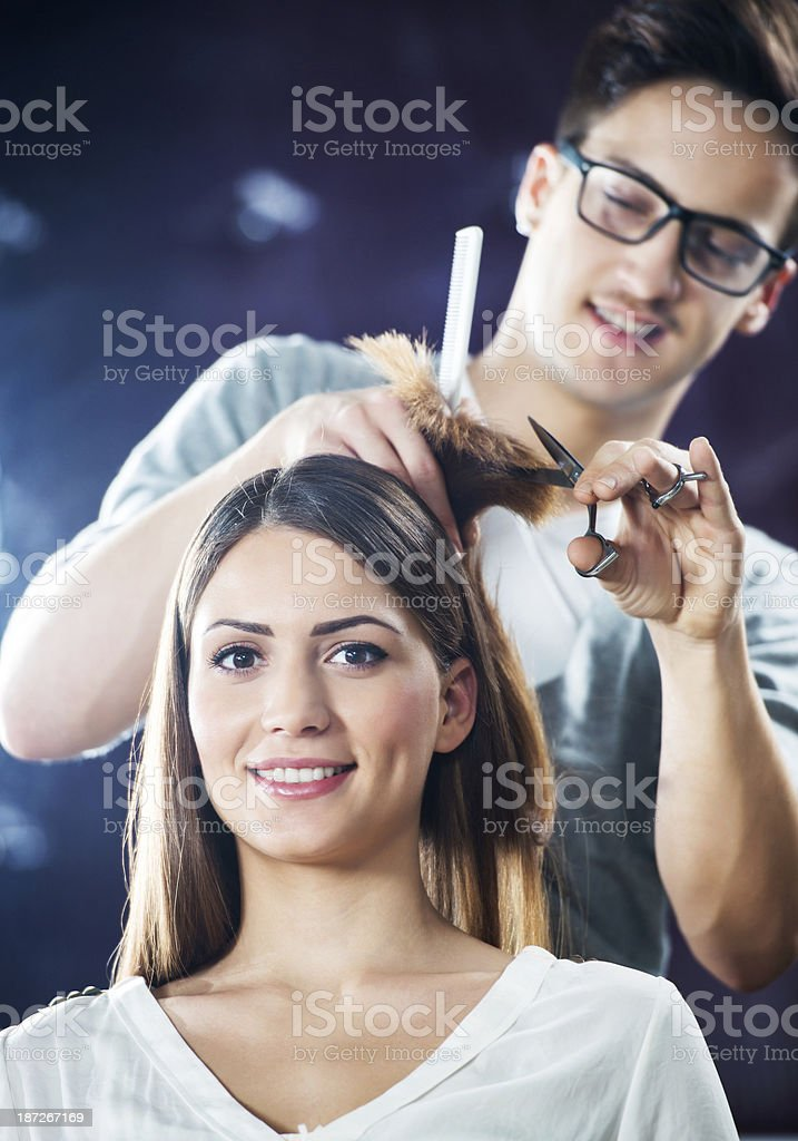 Hairdresser with his customer. stock photo