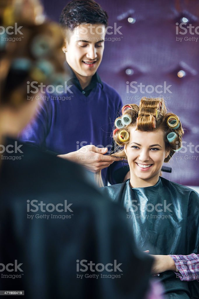 Hairdresser working on woman's hair. royalty-free stock photo