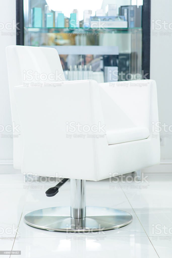 Hairdressers chair is ready to serve its customers stock photo