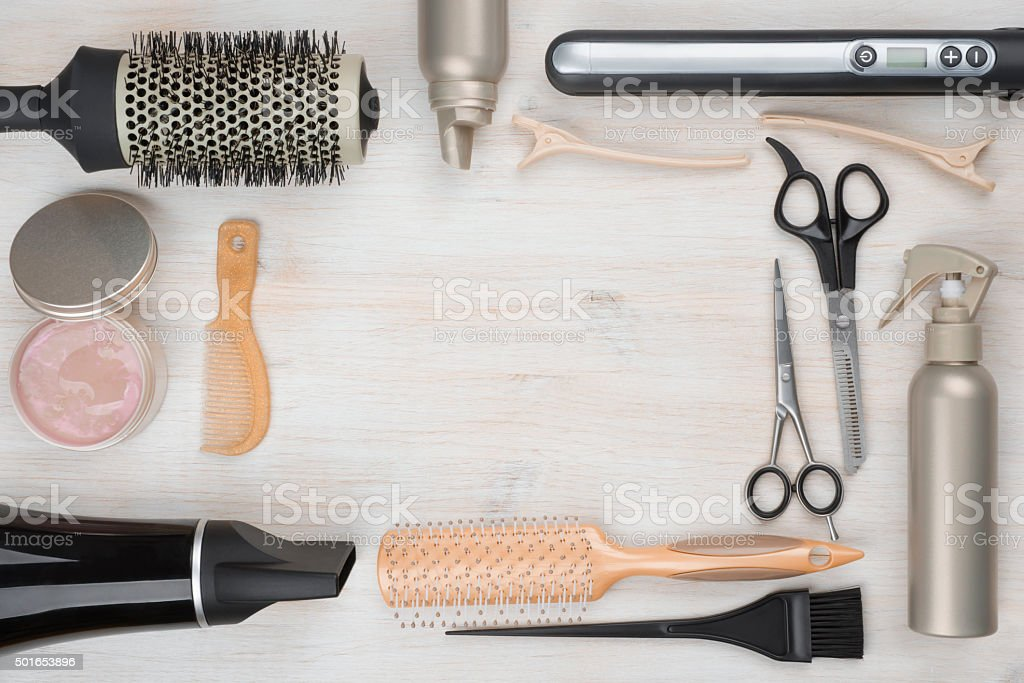 Hairdressing tools on wooden background with copyspace in the middle stock photo