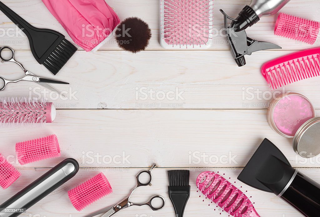 Hairdressing tools on wooden planks background with copyspace in centre stock photo