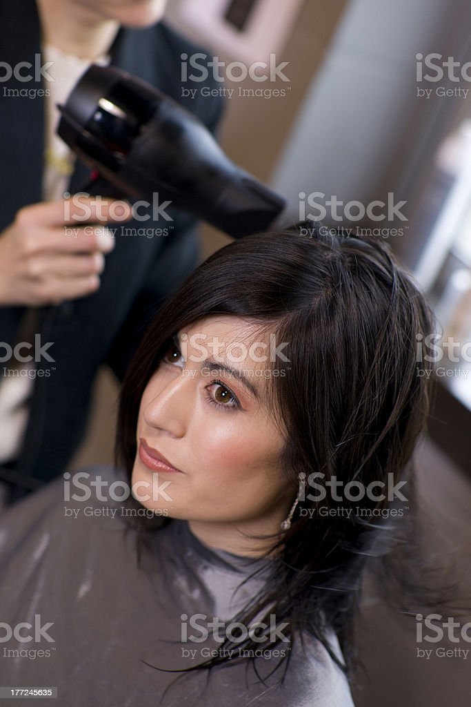 Hairdry for a Regular Customer at The Day Spa stock photo