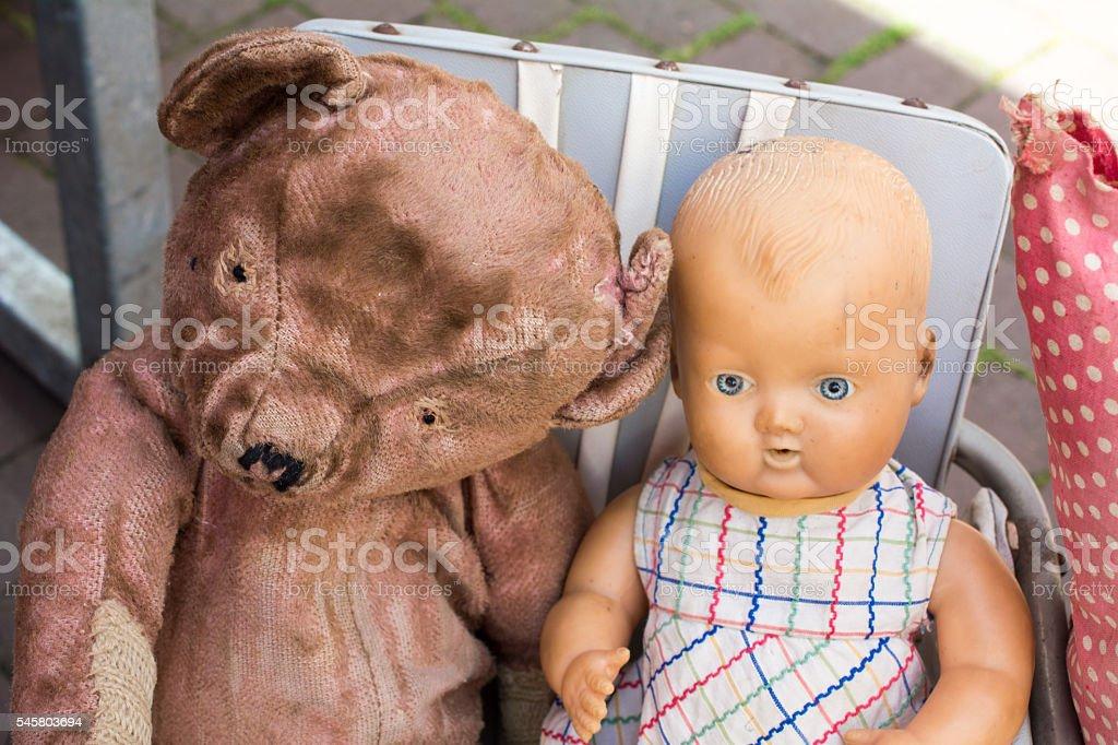 Hairless Blind Bear  baby girl doll on brocante market stock photo